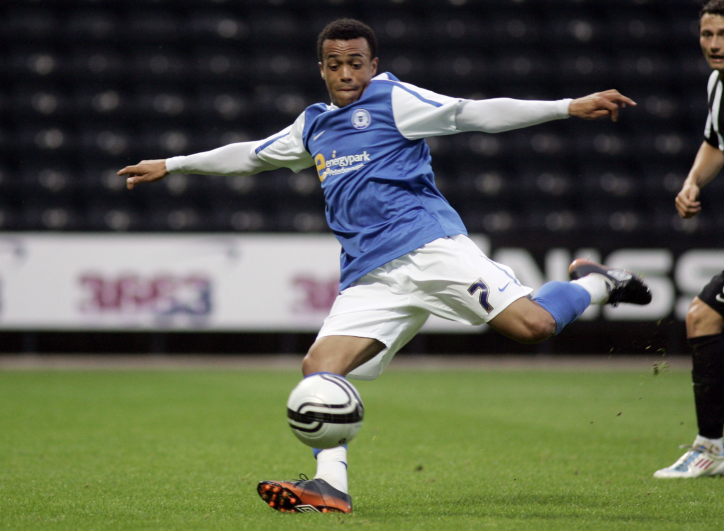 Nicky Ajose taking a shot in pre-season against Notts County