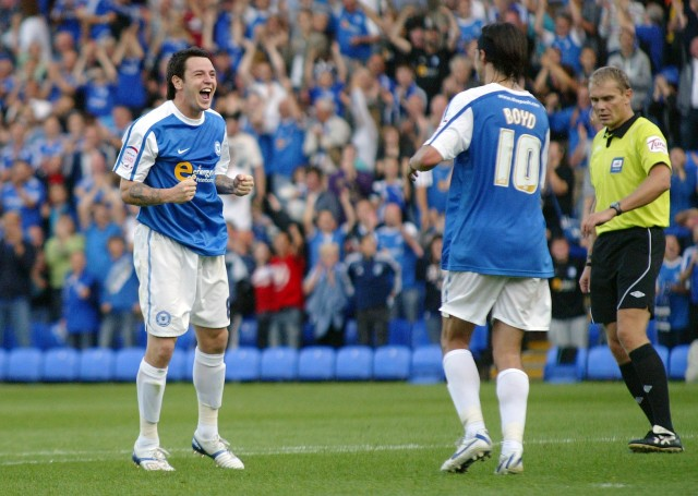 Lee Tomlin celebrates his hat-trick