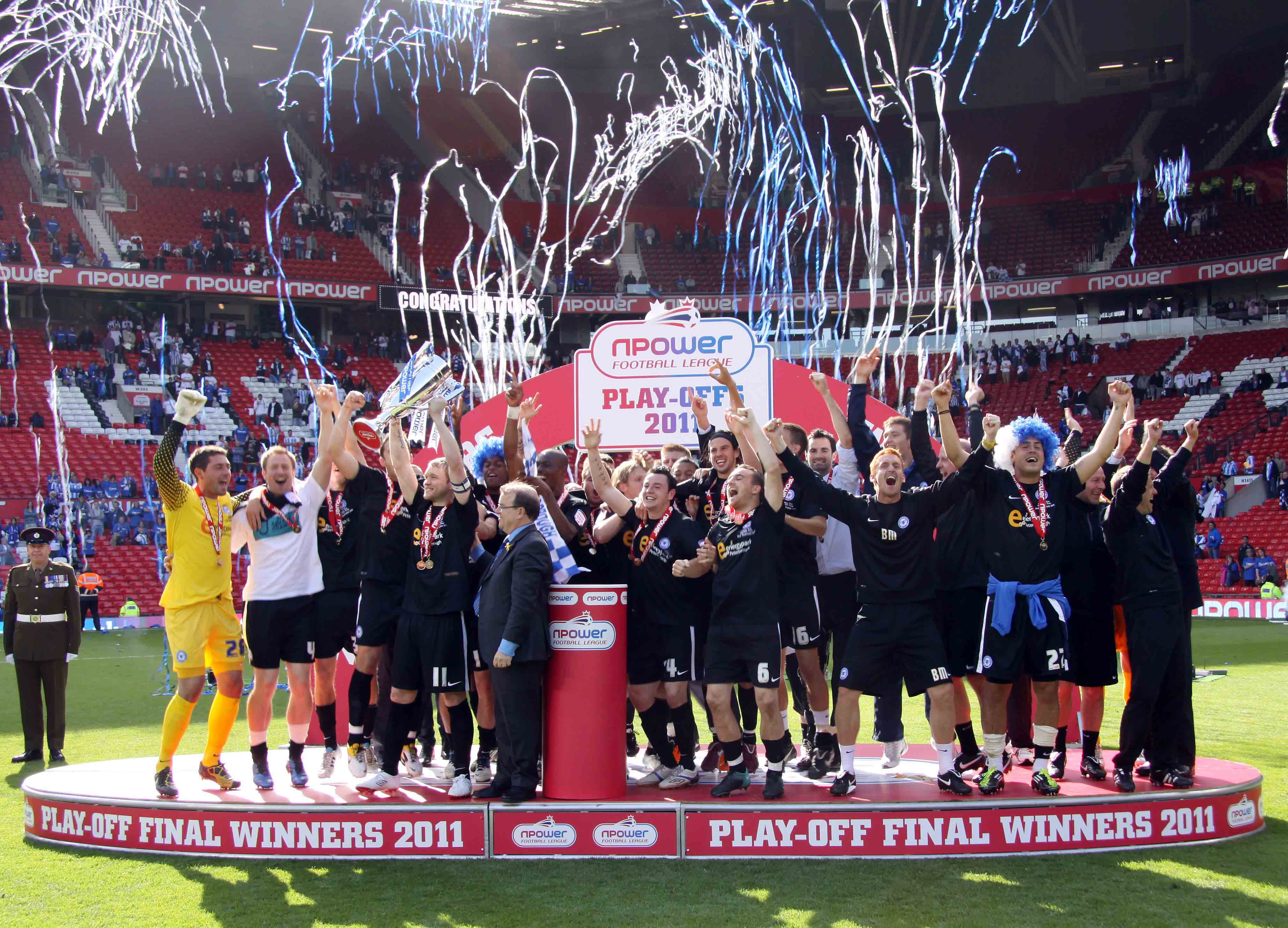 Posh celebrate winning promotion in the League One Play-Offs