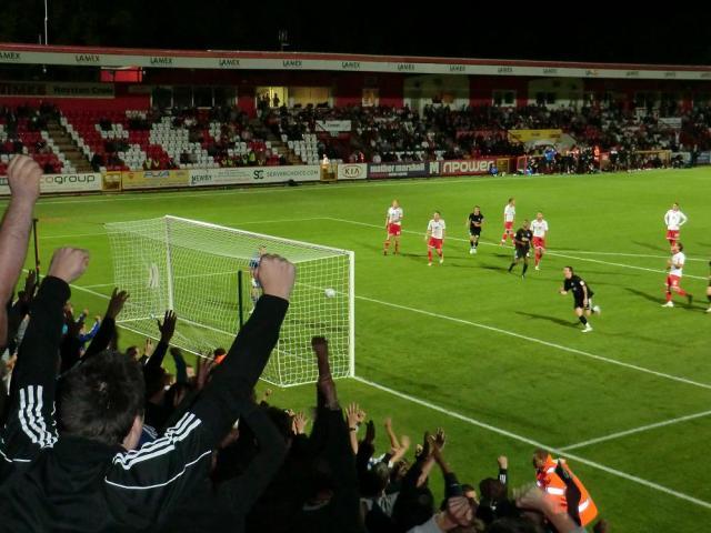 Tomlin slotting away match winning penalty as fans celebrate