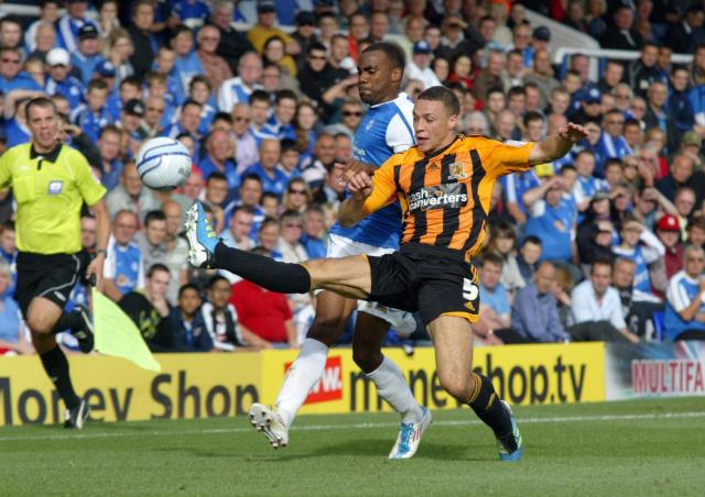 James Chester beats debutant Emile Sinclair to the ball