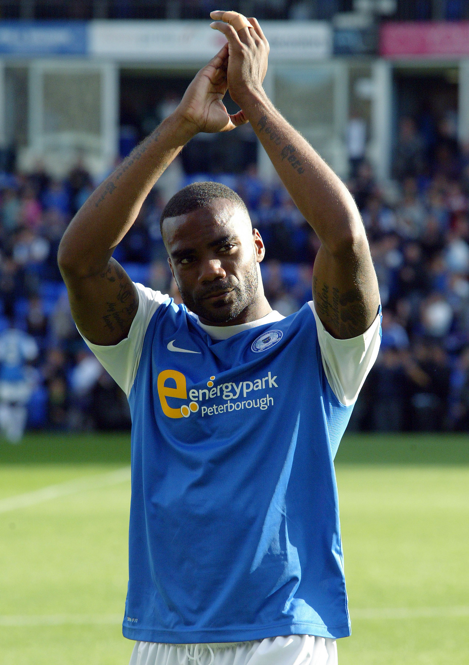 Emile Sinclair (Peterborough United) applaudes the fans at the end of the match