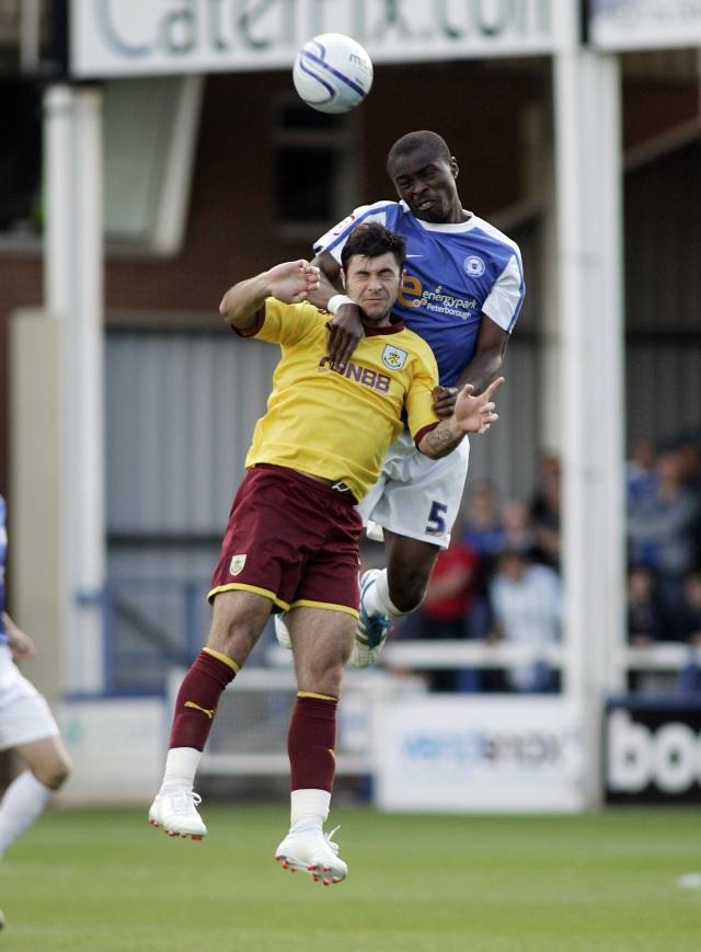 Gabriel Zakuani (Peterborough United) beats Charlie Austin (Burnley)
