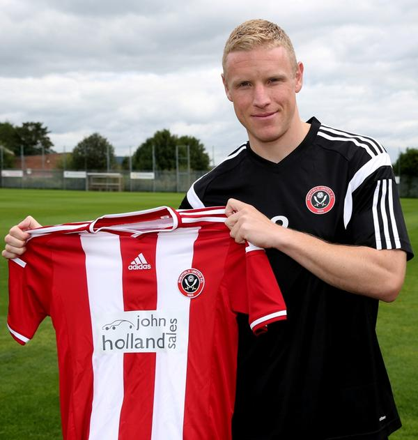 Craig Alcock signs for Sheff United