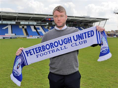 Grant McCann with Posh scarf