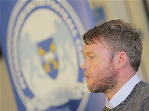 Grant McCann with PUFC badge