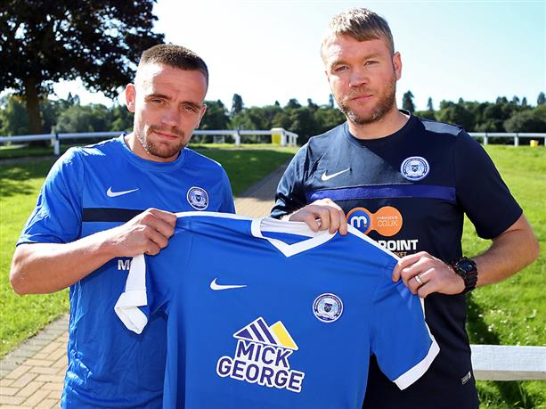 Paul Taylor with Grant McCann holding Posh shirt after signing 1 yeaqr contract