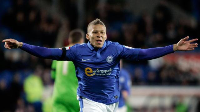 Dwight Gayle celebrates scoring Poshs second goal against Cardiff