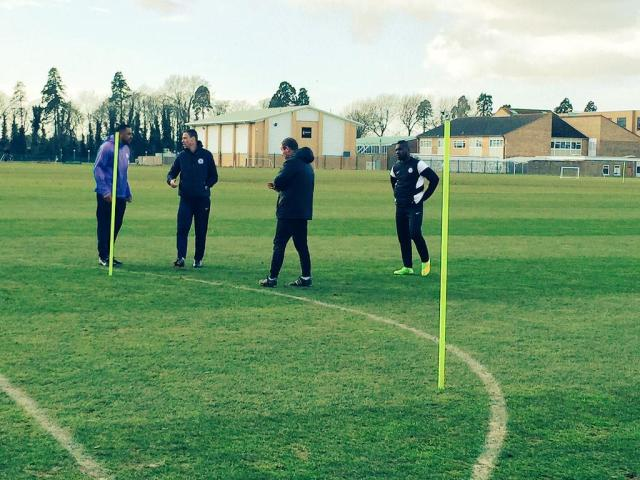 Ken Charlery and Dave Farrell help out training at Posh