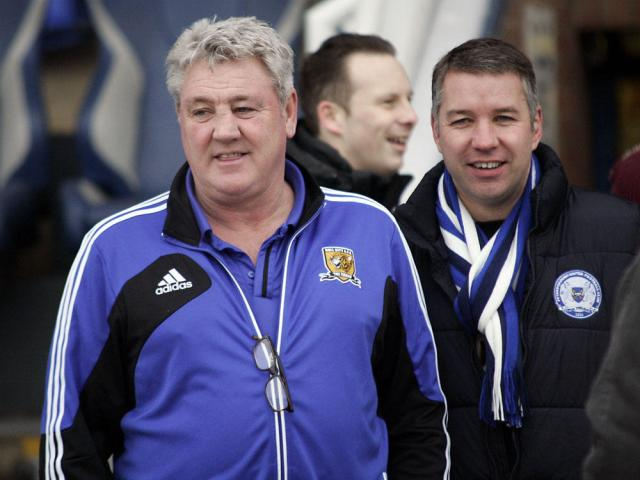 Steve Bruce and Darren Ferguson inspect the pitch after the snow was cleared