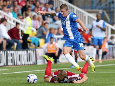 Danny Kearns skips round his man v Swindon