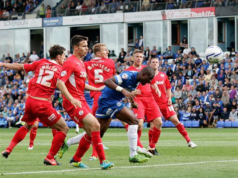 Gaby Zakuani heads straight at Paul Jones in Crawley goal
