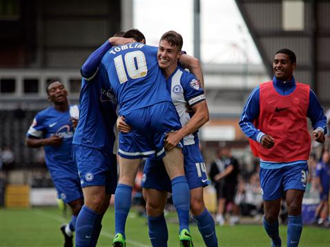 Players celebrate Tommy Rowes goal v Notts County
