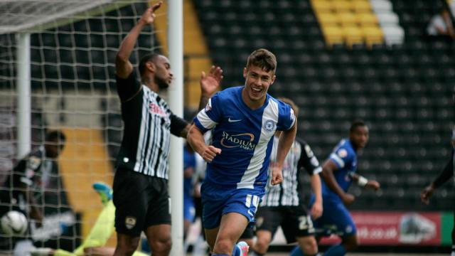 Tommy Rowe celebrates his goal v Notts County