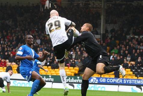 Bobby Olejnik receives boot to his arm and face from Port Vales Lee Hughes