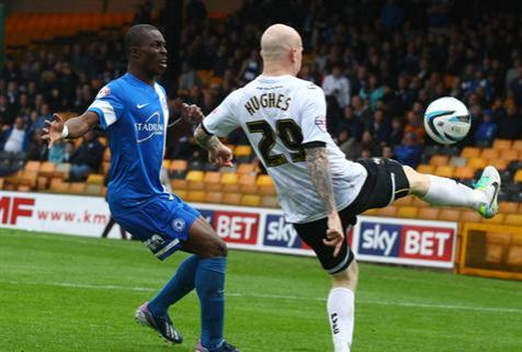 Gaby Zakuani defending against Lee Hughes of Port Vale
