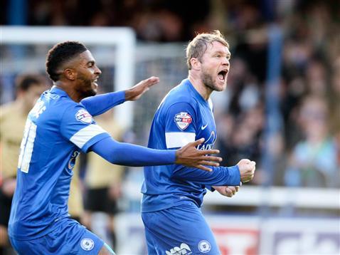 Grant McCann and Mark Little celebrate v Leyton Orient
