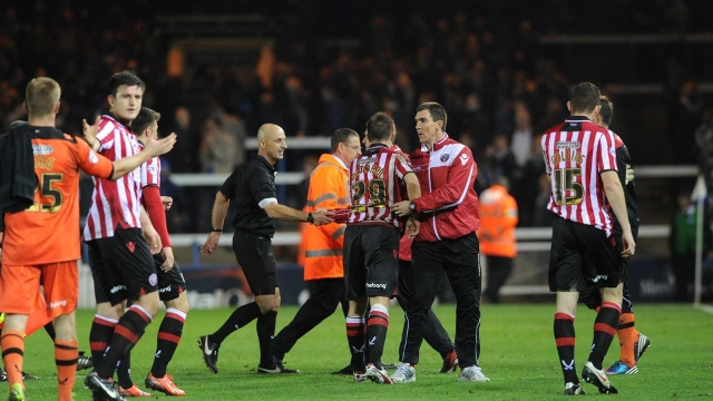 Jubilant Sheff Utd players after draw with Posh