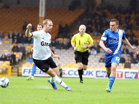 Referee Mike Bull watches Paul Taylor v Port Vale