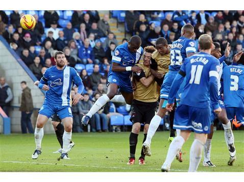Posh defending corner against Lisbie of Leyton Orient