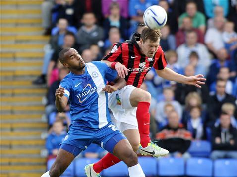 Tyrone Barnett challenging in air v Preston