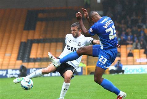 Tyrone Barnett defending again v Port Vale