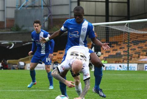 What is Gaby Zakuani doing to Lee Hughes at Port Vale