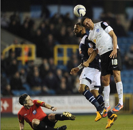 Darren Bond takes a tumble during the Milwall 1-5 Posh match