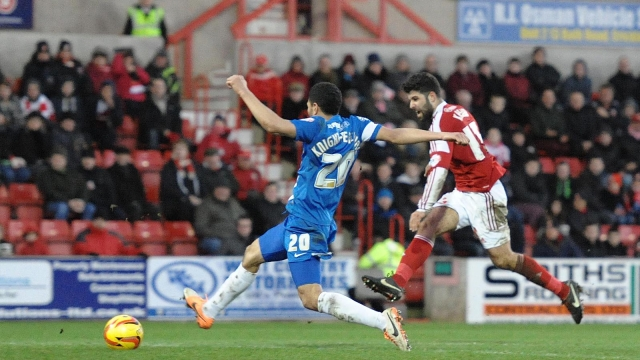 Nat Knight-Percival fails to stop Swindon goal