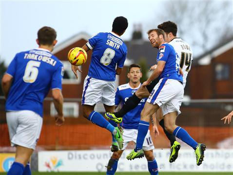 Tommy Rowe heads goal number two for Posh v Oldham