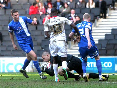 Bobby Olejnik with Craig Alcock and Ben Nugent v MK Dons