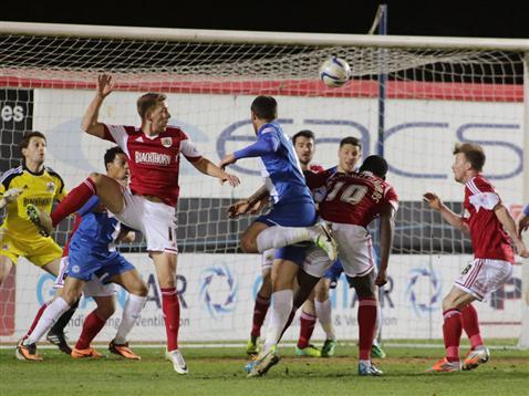 Michael Bostwick heads goalbound v Bristol City