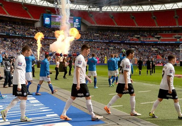 Teams enter the pitch