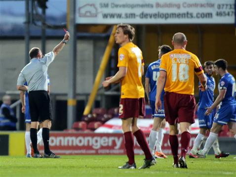 Andy Haines shows Shaun Brisley a red card