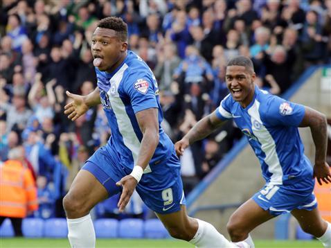 Britt Assombalonga and Mark Little celebrate goal v Leyton Orient