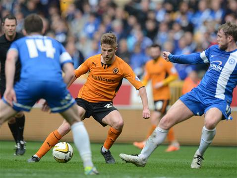 Grant McCann and Tommy Rowe try to stop Michael Jacobs of Wolves