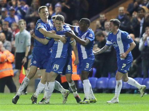 Players celebrate Tommy Rowes goal v Gillingham 2