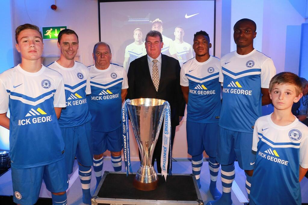 Mick George with Posh players and Johnstones Paint Trophy at kit launch