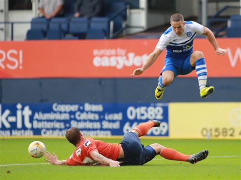 Conor Washington being tackled v Luton