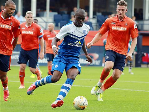 Gaby Zakuani surrounded by Luton players