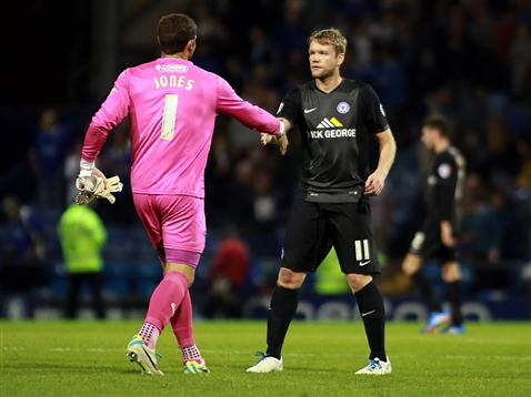 Grant McCann shakes ex-Posh keeper Paul Jones hand after defeat to Portsmouth