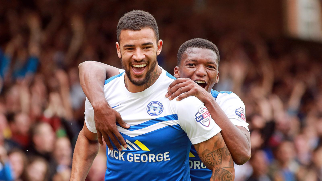 Kyle Vassell celebrates scoring one of his two goals against MK Dons