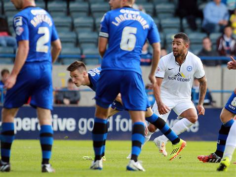 Kyle Vassell  watches his shot go in v Rochdale