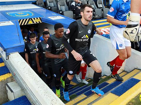 Michael Smith enters the pitch to make his debut for Posh v Portsmouth