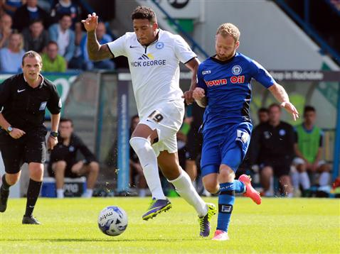 Geoff Eltringham watches Nathaniel Mendez-Laing beat his man at Rochdale