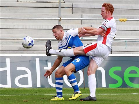 Conor Washington receiving unwanted attention from MK Dons Dean Lewington