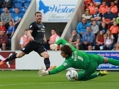 Conor Washington watches the ball go past the keeper for the opening goal v Colchester