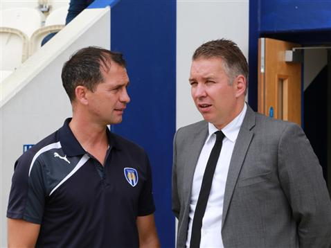 Darren Ferguson talks to Colchester manager Joe Dunne