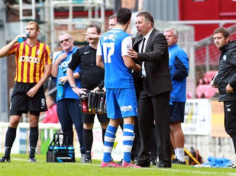 Joe Newell receiving instructions from Darren Ferguson v Bradford