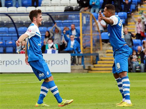 Kenny McEvoy and Nathaniel Mendez-Laing celebrate McEvoy first ever League goal v MK Dons